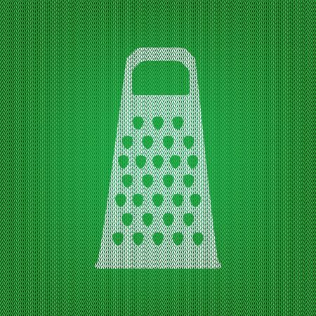 Cheese grater sign. white icon on the green knitwear or woolen cloth texture.