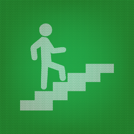going green: Man on Stairs going up. white icon on the green knitwear or woolen cloth texture.