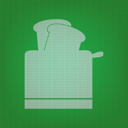 Toaster simple sign. white icon on the green knitwear or woolen cloth texture.