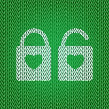 lock sign with heart shape. A simple silhouette of the lock. Shape of a heart. white icon on the green knitwear or woolen cloth texture.