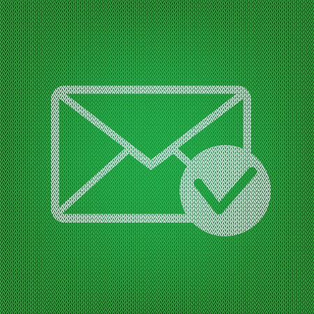 Mail sign illustration with allow mark. white icon on the green knitwear or woolen cloth texture.