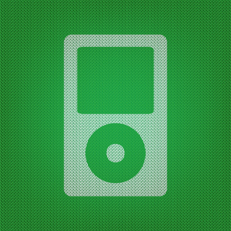 portable audio: Portable music device. white icon on the green knitwear or woolen cloth texture.