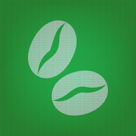 Coffee beans sign. white icon on the green knitwear or woolen cloth texture.