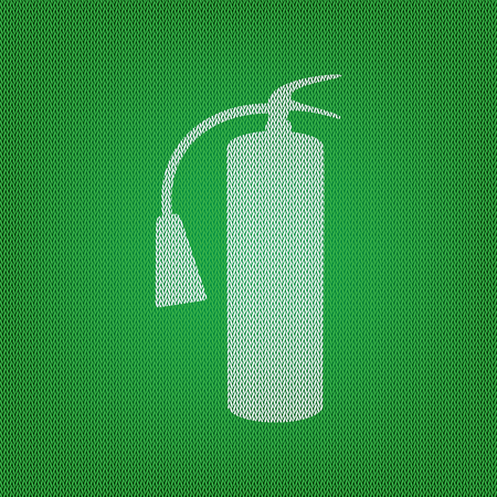 Fire extinguisher sign. white icon on the green knitwear or woolen cloth texture.
