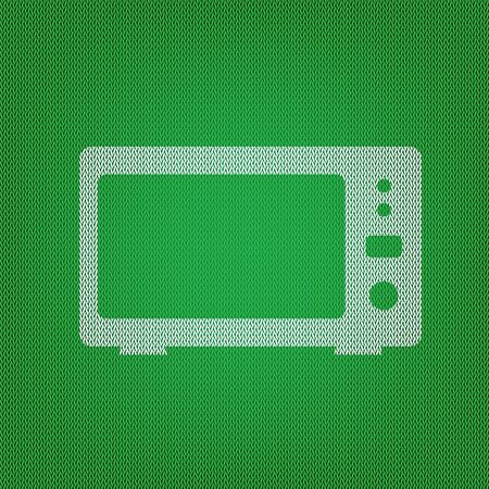 Microwave sign illustration. white icon on the green knitwear or woolen cloth texture.