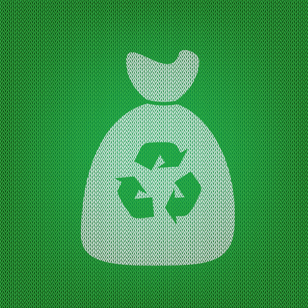 Trash bag icon. white icon on the green knitwear or woolen cloth texture.