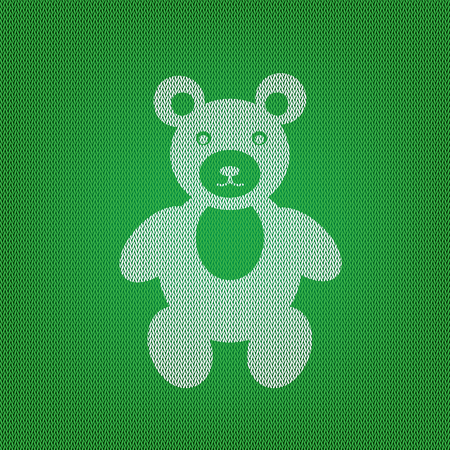 Teddy bear sign illustration. white icon on the green knitwear or woolen cloth texture. Illustration