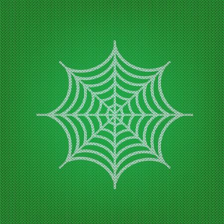 Spider op web illustratie. wit pictogram op de groene gebreide of wollen doektextuur.