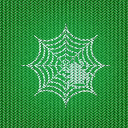 Spider on web illustration white icon on the green knitwear or woolen cloth texture.