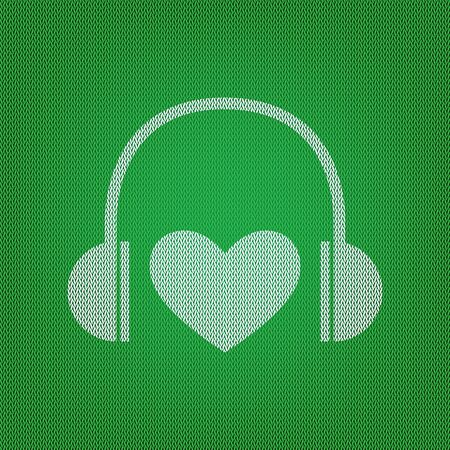 Headphones with heart. white icon on the green knitwear or woolen cloth texture.