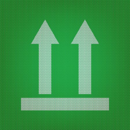 Logistic sign of arrows. white icon on the green knitwear or woolen cloth texture.