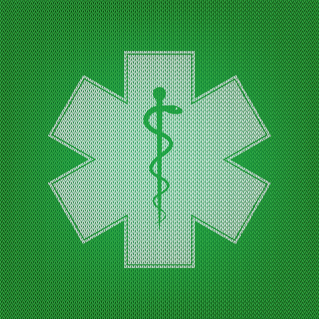 Medical symbol of the Emergency or Star of Life. white icon on the green knitwear or woolen cloth texture. Illustration