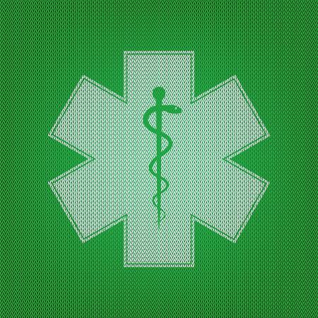 estrella de la vida: símbolo médico de la emergencia o Estrella de la vida. icono blanco en el tejido de punto verde o textura de lana tela.