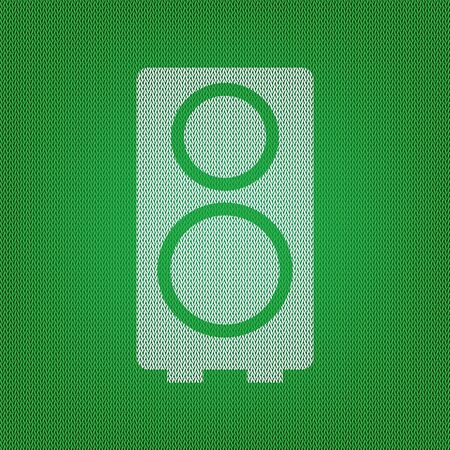 Speaker sign illustration. white icon on the green knitwear or woolen cloth texture.