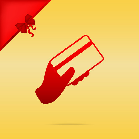 Hand holding a credit card. Cristmas design red icon on gold background. Illustration