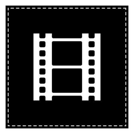 Reel of film sign. Black patch on white background. Isolated.