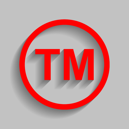 Trade mark sign Red icon with soft shadow on gray background.
