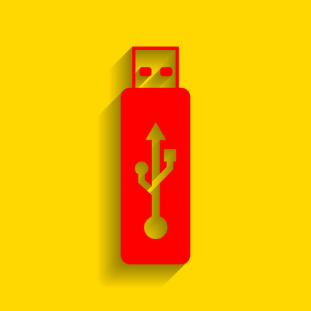 Vector USB flash drive sign. Vector. Red icon with soft shadow on golden background.