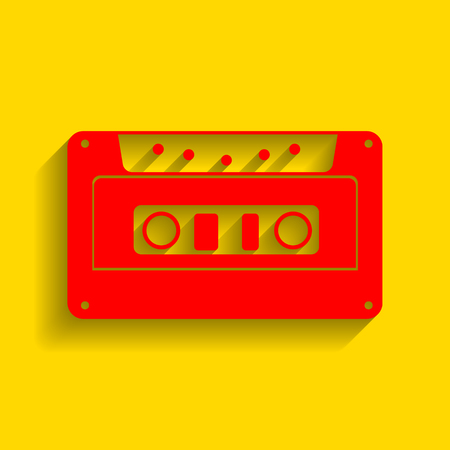 Cassette icon, audio tape sign. Vector. Red icon with soft shadow on golden background.
