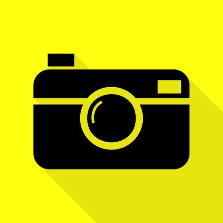 Digital photo camera sign. Black icon with flat style shadow path on yellow background.