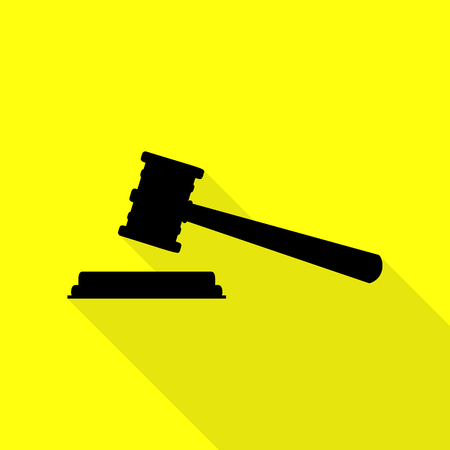 Justice hammer sign. Black icon with flat style shadow path on yellow background.