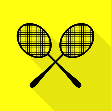 Tennis racquets sign. Black icon with flat style shadow path on yellow background.