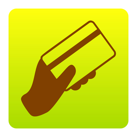 Hand holding a credit card. Vector. Brown icon at green-yellow gradient square with rounded corners on white background. Isolated. Illustration