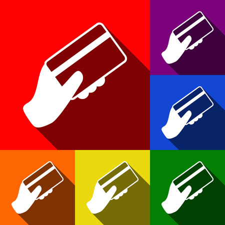 Hand holding a credit card. Vector. Set of icons with flat shadows at red, orange, yellow, green, blue and violet background. Illustration