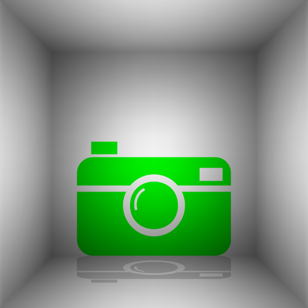 Digital photo camera sign. Vector. Green icon with shadow in the room.