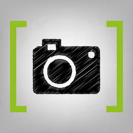 capturing: Digital camera sign. Vector. Black scribble icon in citron brackets on grayish background.