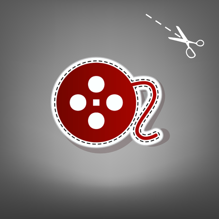 Film circular sign. Vector. Red icon with for applique from paper with shadow on gray background with scissors.