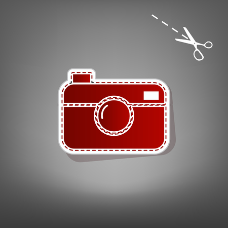Digital photo camera sign. Vector. Red icon with for applique from paper with shadow on gray background with scissors.