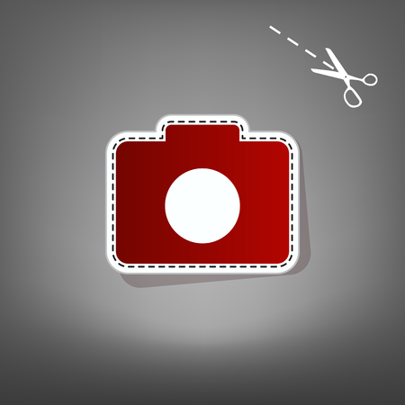 Digital camera sign. Vector. Red icon with for applique from paper with shadow on gray background with scissors. Illustration