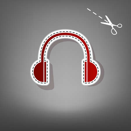 Headphones sign illustration. Vector. Red icon with for applique from paper with shadow on gray background with scissors. Stock Photo