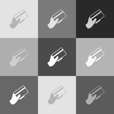 spending: Hand holding a credit card. Vector. Grayscale version of Popart-style icon.