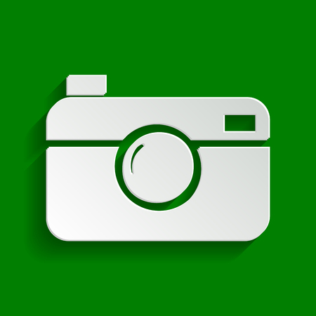 Digital photo camera sign. Vector. Paper whitish icon with soft shadow on green background.