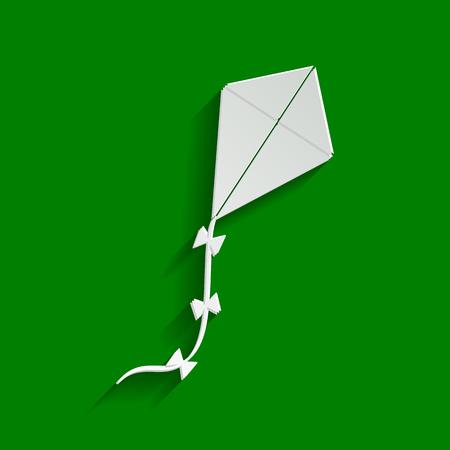 Señal de kite Vector. Papel icono blanquecino con suave sombra sobre fondo verde.