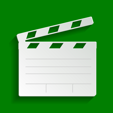 Film clap board cinema sign. Vector. Paper whitish icon with soft shadow on green background.