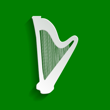 Musical instrument harp sign. Vector. Paper whitish icon with soft shadow on green background.