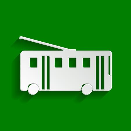 Trolleybus-bord. Vector. Papier witachtig pictogram met zachte schaduw op groene achtergrond.