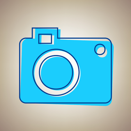 camera film: Digital camera sign. Vector. Sky blue icon with defected blue contour on beige background.