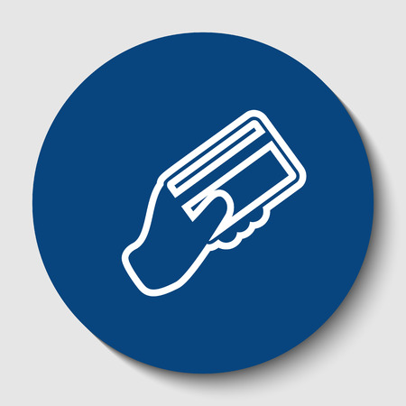 Hand holding a credit card. Vector. White contour icon in dark cerulean circle at white background. Isolated.