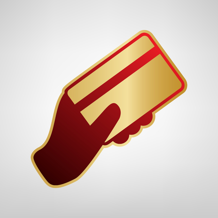 Hand holding a credit card. Vector. Red icon on gold sticker at light gray background.