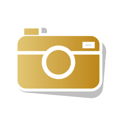 Digital photo camera sign. Vector. Golden gradient icon with white contour and rotated gray shadow at white background.