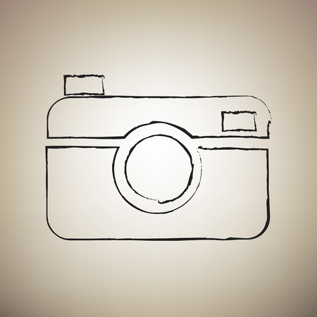 Digital photo camera sign. Vector. Brush drawed black icon at light brown background. 일러스트