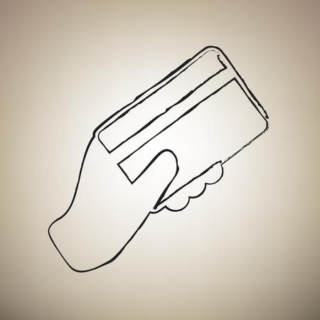 Hand holding a credit card. Vector. Brush drawed black icon at light brown background.