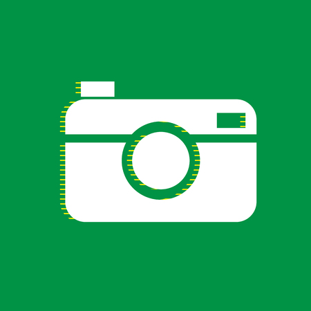 Digital photo camera sign. Vector. White flat icon with yellow striped shadow at green background.