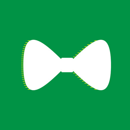 Bow Tie icon. Vector. White flat icon with yellow striped shadow at green background.