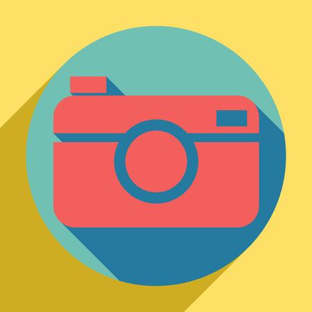 Signo de cámara de fotos digital. Icono naranja al atardecer con sombra de llapis lazuli dentro de un círculo aguamarina medio con diferente sombra de vara de oro sobre fondo amarillo real.