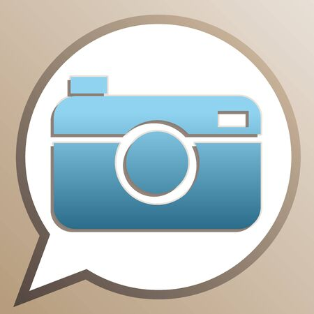 Digital photo camera sign. Bright cerulean icon in white speech balloon at pale taupe background.